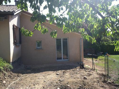 extension d'une maison de 60 m² et ravalement de façade à Vourles